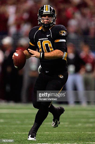 Quarterback Chase Daniel of the Missouri Tigers drops back to pass in the second quarter against the Oklahoma Sooners during the Big 12 Championship...