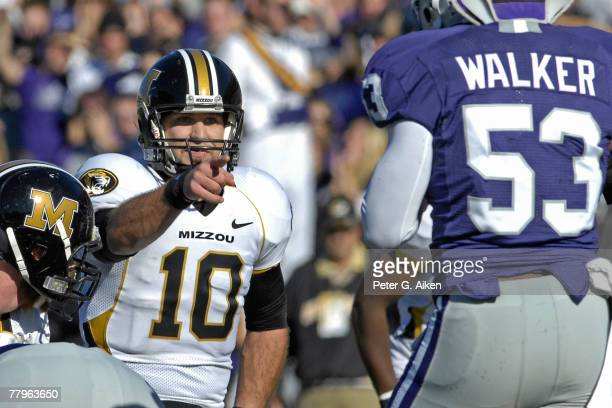Quarterback Chase Daniel of the Missouri Tigers points of linebacker Reggie Walker of the Kansas State Wildcats in the first half at Bill Snyder...