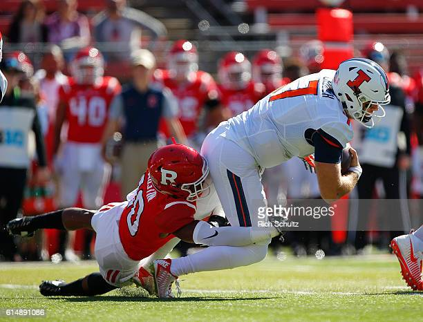 Quarterback Chayce Crouch of Illinois is sacked by Blessuan Austin of Rutgers during the first quarter of a game on October 15 2016 in Piscataway New...