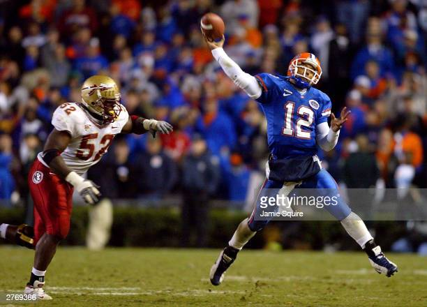 Quarterback Chris Leak of the Florida Gators passes as he is chased by Brodrick Bunkley of the Florida State Seminoles during the second half of the...