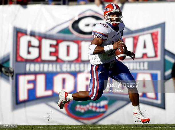 Quarterback Chris Leak of the Florida Gators rolls out to pass during a game against the Georgia Bulldogs on October 28 2006 at Alltel Stadium in...