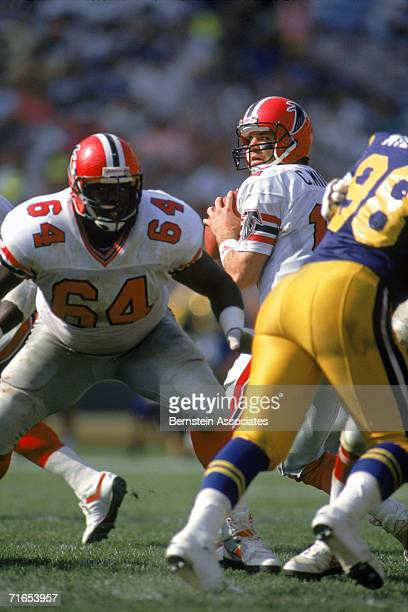 Quarterback Chris Miller of the Atlanta Falcons pulls back the pass against the Los Angeles Rams at Anaheim Stadium on October 8 1989 in Anaheim...
