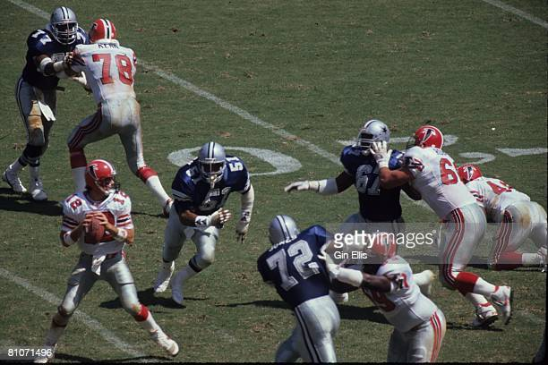 Quarterback Chris Miller of the Atlanta Falcons sets up to pass against the Dallas Cowboys in Atlanta FultonCounty Stadium on September 17 1989 in...
