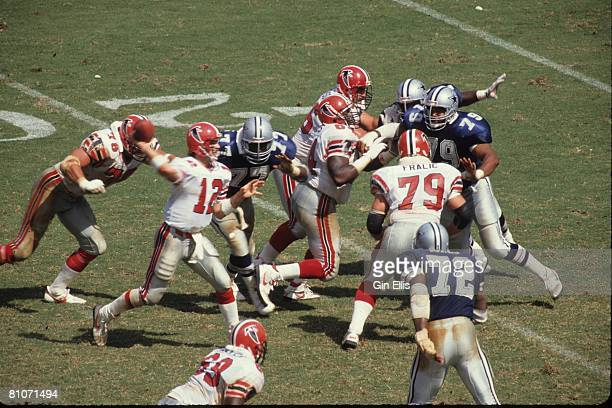 Quarterback Chris Miller of the Atlanta Falcons throws a pass against the Dallas Cowboys in Atlanta FultonCounty Stadium on September 17 1989 in...