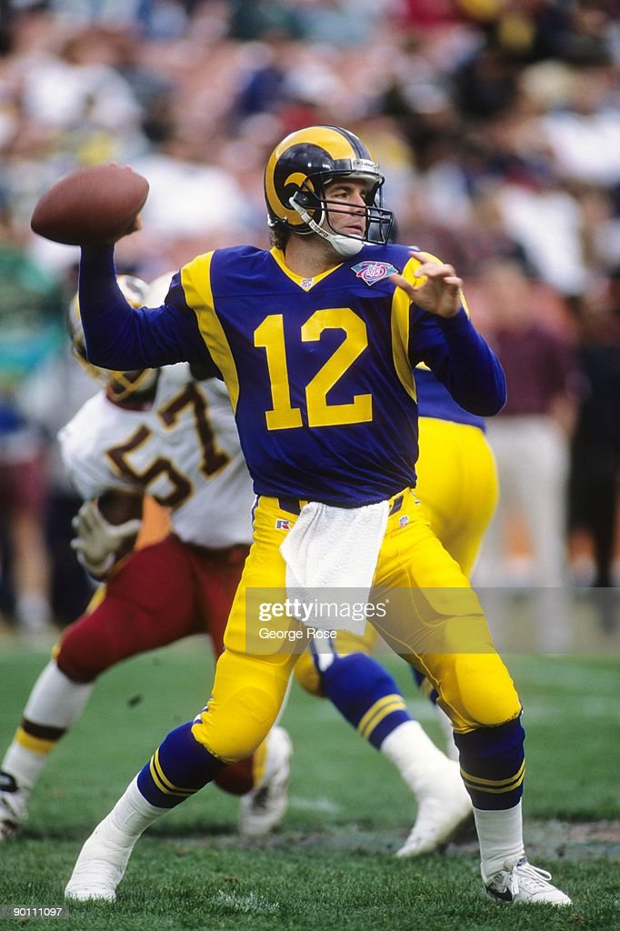 Quarterback Chris Miller #12 of the Los Angeles Rams throws a pass during a game against the Washington Redskins at Anaheim Stadium on December 24, 1994 in Anaheim, California. The Redskins won 24-21.