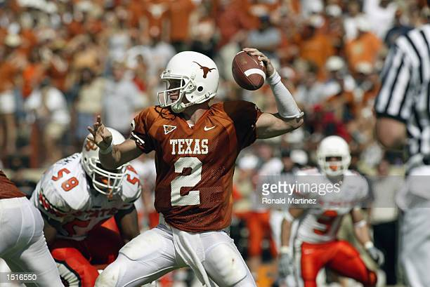 Quarterback Chris Simms of the Texas Longhorns throws a pass during the Big 12 Conference football game against the Oklahoma State Cowboys on October...