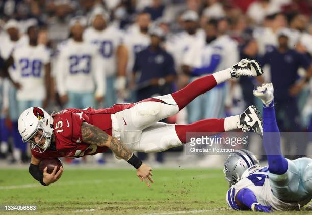 Quarterback Chris Streveler of the Arizona Cardinals dives with the football against the Dallas Cowboys during the second half of the NFL preseason...