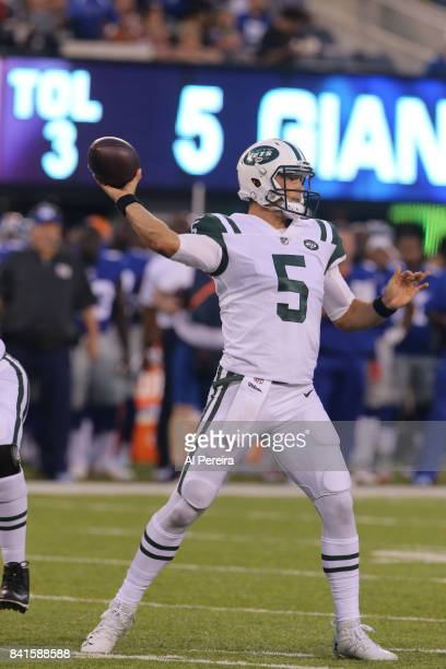 Quarterback Christian Hackenberg of the New York Jets passes the ball against the New York Giants during a preseason game on August 26, 2017 at...
