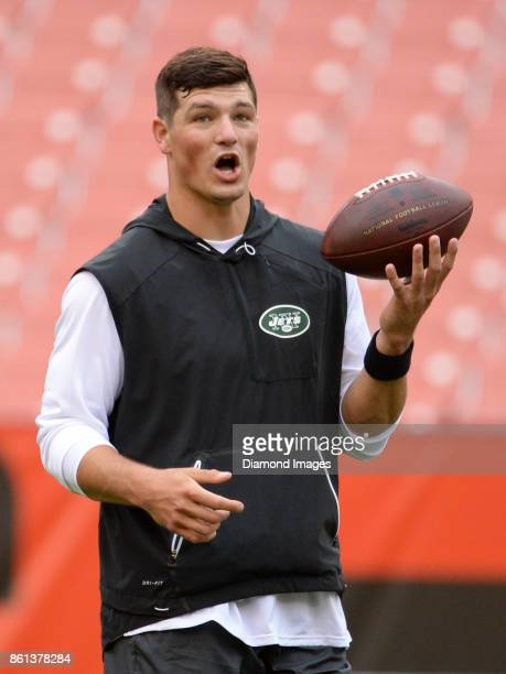 Quarterback Christian Hackenberg of the New York Jets takes part in warm ups prior to a game on October 8, 2017 against the Cleveland Browns at...
