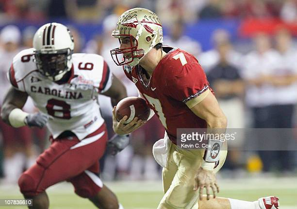 Quarterback Christian Ponder of the Florida State Seminoles rushes upfield against Ace Sanders of the South Carolina Gamecocks during the 2010...