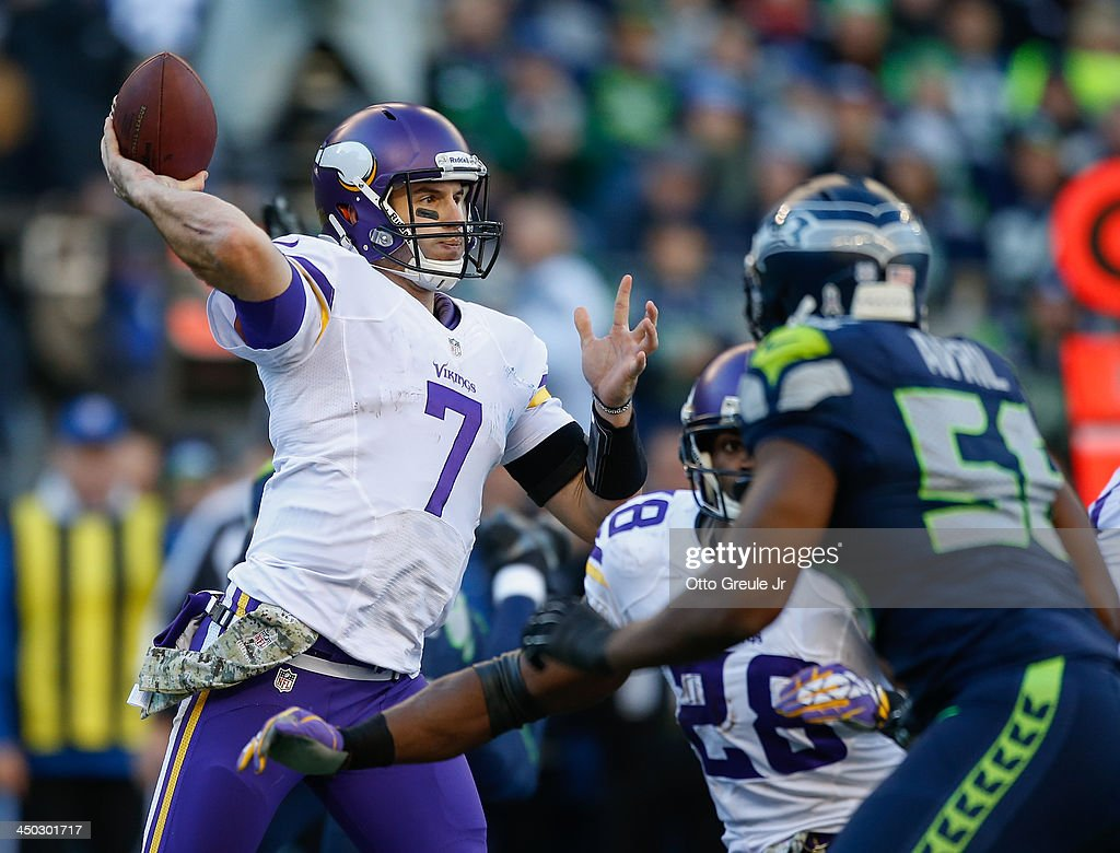 Quarterback Christian Ponder #7 of the Minnesota Vikings passes against the Seattle Seahawks at CenturyLink Field on November 17, 2013 in Seattle, Washington. The Seahawks defeated the Vikings 41-20.