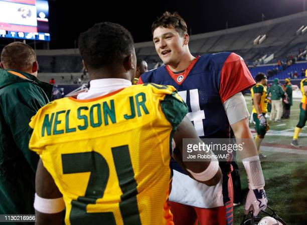 Quarterback ChristianHackenberg of the Memphis Express congratulates Robert Nelson of the Arizona Hotshots after the Alliance of American Football...