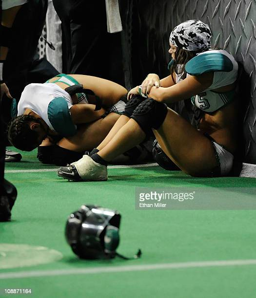 Quarterback Christy Bell and Danielle Gassler of the Philadelphia Passion react after the team's 2625 loss to the Los Angeles Temptation in the...