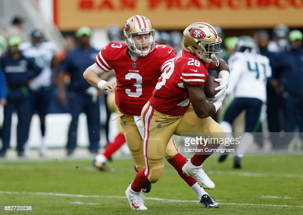 Quarterback CJ Beathard hands off to running back Carlos Hyde of the San Francisco 49ers against the Seattle Seahawks at Levi's Stadium on November...