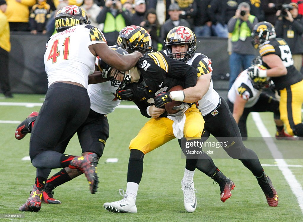 Quarterback C.J. Beathard #16 of the Iowa Hawkeyes is sacked by (left to right) defensive lineman Jesse Aniebonam #41, defensive linemanYannick Ngakoue #7 and linebacker Brett Zanotto #38 of Maryland Terrapins in the second half on October 31, 2015 at Kinnick Stadium, in Iowa City, Iowa.