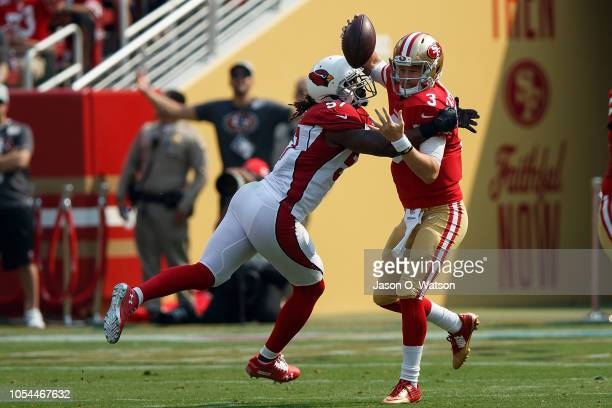 Quarterback C.J. Beathard of the San Francisco 49ers is sacked by linebacker Josh Bynes of the Arizona Cardinals during the first quarter at Levi's...