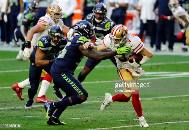 Quarterback C.J. Beathard of the San Francisco 49ers is tackled by defensive end Benson Mayowa of the Seattle Seahawks during the second quarter at...