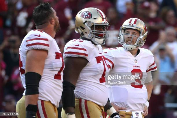 Quarterback CJ Beathard of the San Francisco 49ers looks on after throwing an interception against the Washington Redskins during the fourth quarter...