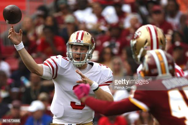 Quarterback CJ Beathard of the San Francisco 49ers passes against the Washington Redskins during the second quarter at FedExField on October 15 2017...