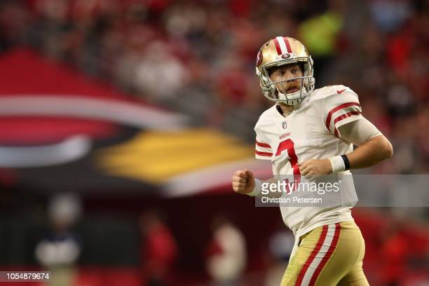 Quarterback CJ Beathard of the San Francisco 49ers runs off the field during the NFL game against the Arizona Cardinals at State Farm Stadium on...