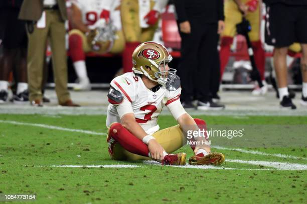 Quarterback CJ Beathard of the San Francisco 49ers sits on the field after throwing an incomplete pass at the end of the fourth quarter against the...