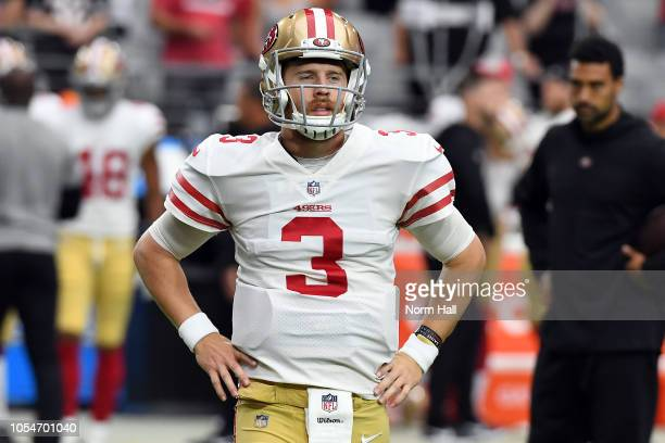 Quarterback CJ Beathard of the San Francisco 49ers warms up before the game against the Arizona Cardinals at State Farm Stadium on October 28 2018 in...