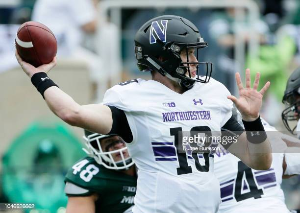 Quarterback Clayton Thorson of the Northwestern Wildcats passes against the Michigan State Spartans during the first half at Spartan Stadium on...