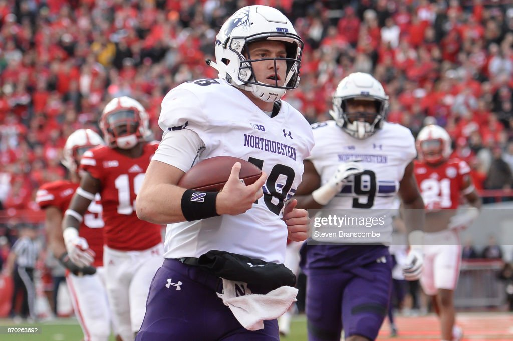 Quarterback Clayton Thorson #18 of the Northwestern Wildcats scores against the Nebraska Cornhuskers at Memorial Stadium on November 4, 2017 in Lincoln, Nebraska.
