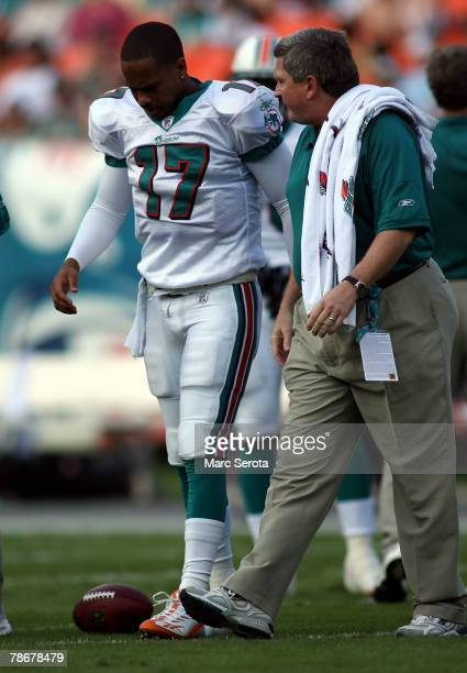 Quarterback Cleop Lemon of the Miami Dolphins walks off the field injured against the Cincinnati Bengals at Dolphin Stadium December 30 2007 in Miami...