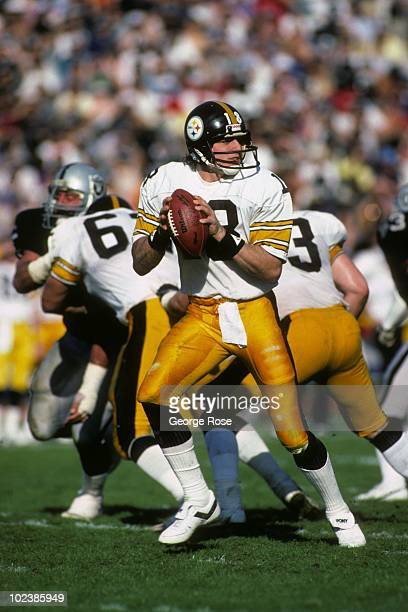 Quarterback Cliff Stoudt of the Pittsburgh Steelers drops back to pass against the Los Angeles Raiders during the 1983 AFC Divisional Playoff game at...