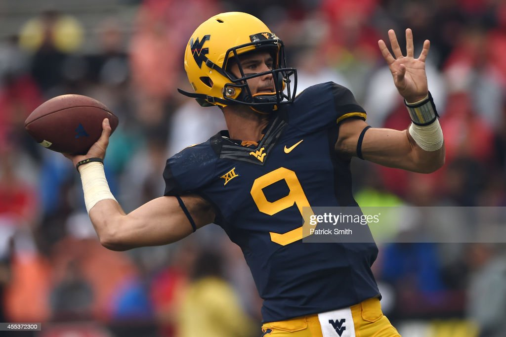 Quarterback Clint Trickett #9 of the West Virginia Mountaineers passes against the Maryland Terrapins in the first quarter during an NCAA college football game at Capital One Field at Byrd Stadium on September 13, 2014 in College Park, Maryland.