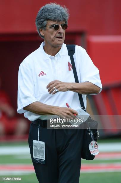 Quarterback coach Mario Verduzco walks the field before the game against the Akron Zips and the Nebraska Cornhuskers at Memorial Stadium on September...