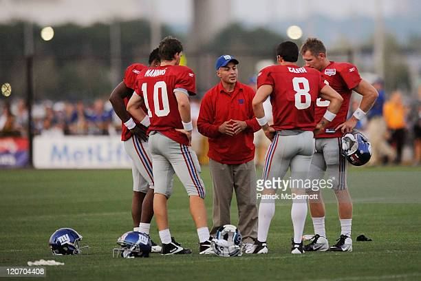 Quarterback coach Mike Sullivan of the New York Giants speaks Eli Manning David Carr Ryan Perrilloux and Sage Rosenfels take part in practice at New...