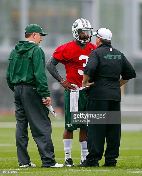 Quarterback Coach quarterbacks coach David Lee left and Offensive Coordinator Marty Mornhinweg talk with Quarter Back Tajh Boyd of the New York Jets...