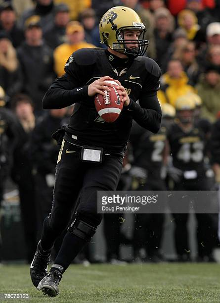 Quarterback Cody Hawkins of the Colorado Buffaloes rolls out and looks for a receiver against the Nebraska Cornhuskers during Big 12 College Football...