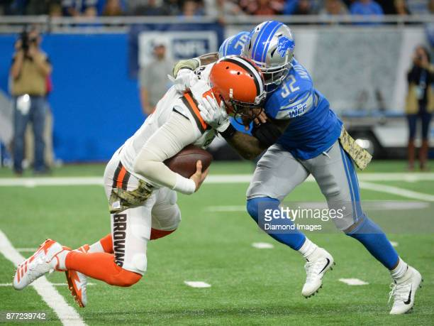 Quarterback Cody Kessler of the Cleveland Browns is sacked by safety Tavon Wilson of the Detroit Lions in the fourth quarter of a game on November 12...