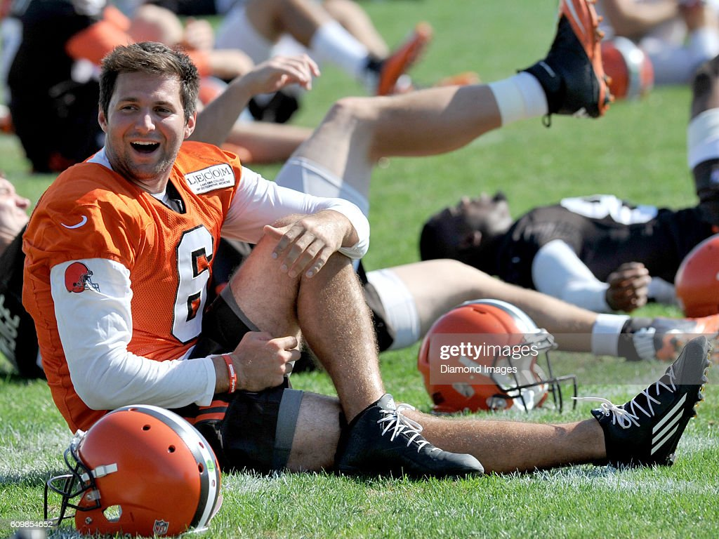 Quarterback Cody Kessler #6 of the Cleveland Browns laughs as he stretches during practice on September 22, 2016 at the Cleveland Browns training complex in Berea, Ohio. Cleveland will travel to play the Miami Dolphins at Hard Rock Stadium in Miami, Florida on September 25, 2016.