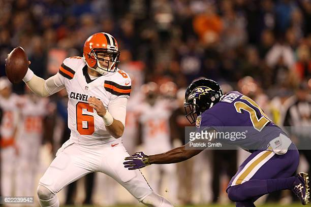 Quarterback Cody Kessler of the Cleveland Browns works under pressure by free safety Lardarius Webb of the Baltimore Ravens in the first quarter at...