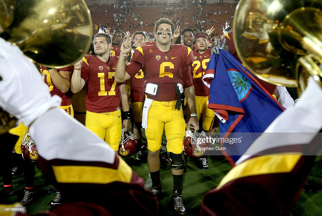 Quarterback Cody Kessler #6 of the USC Trojans celebrates with teammates and the band after the game against the Idaho Vandals at Los Angeles Memorial Coliseum on September 12, 2015 in Los Angeles, California. USC won 59-9.