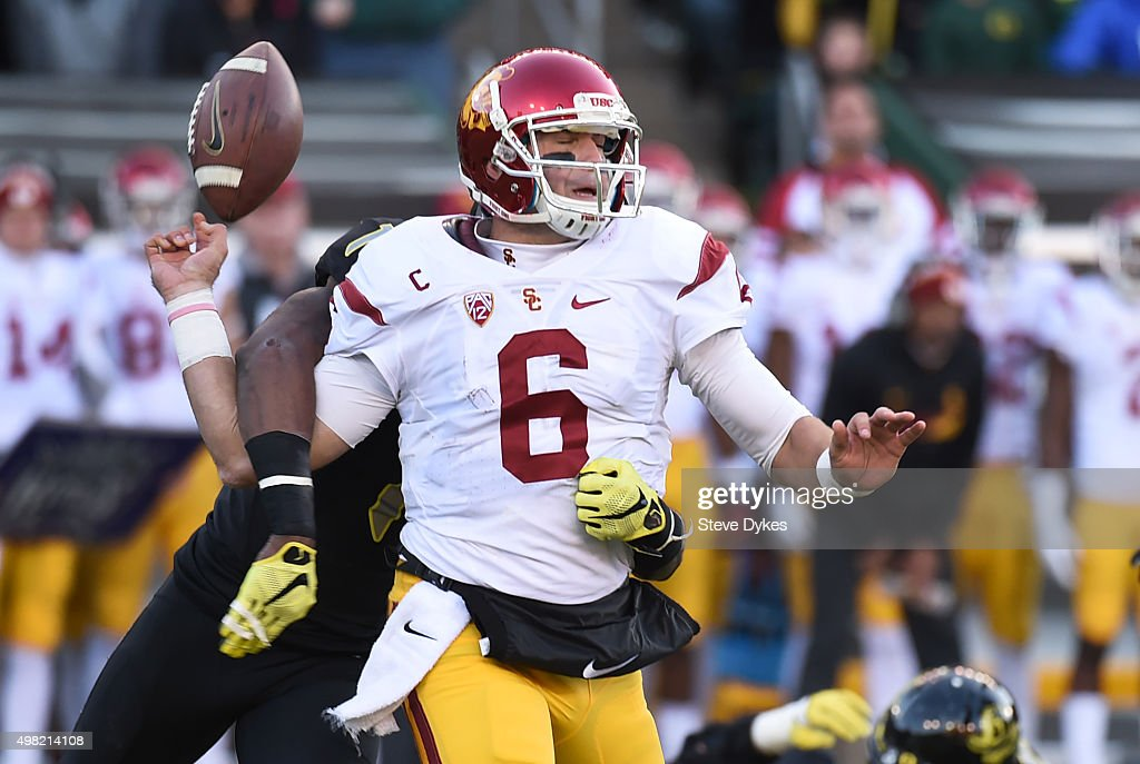 Quarterback Cody Kessler #6 of the USC Trojans fumbles the ball as he is sacked by defensive back Arrion Springs #1 of the Oregon Ducks during the fourth quarter of the game at Autzen Stadium on November 21, 2015 in Eugene, Oregon. The Ducks won the game 48-28.