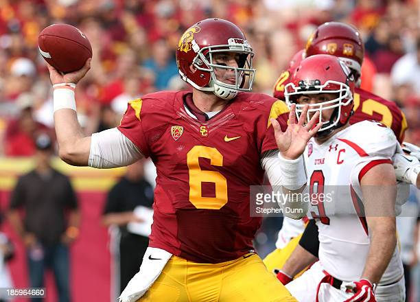 Quarterback Cody Kessler of the USC Trojans throws a pass against the Utah Utes at Los Angeles Coliseum on October 26, 2013 in Los Angeles,...