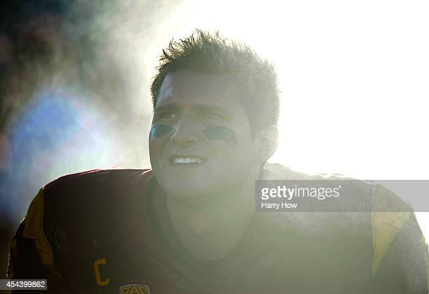 Quarterback Cody Kessler of the USC Trojans watches from the sidelines with his team leading 31-7 over the Fresno State Bulldogs during the second...