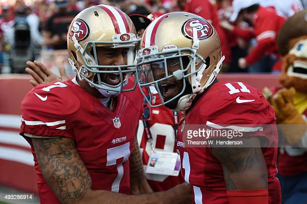 Quarterback Colin Kaepernick and wide receiver Quinton Patton of the San Francisco 49ers celebrate after a 21yard touchdown pass against the...