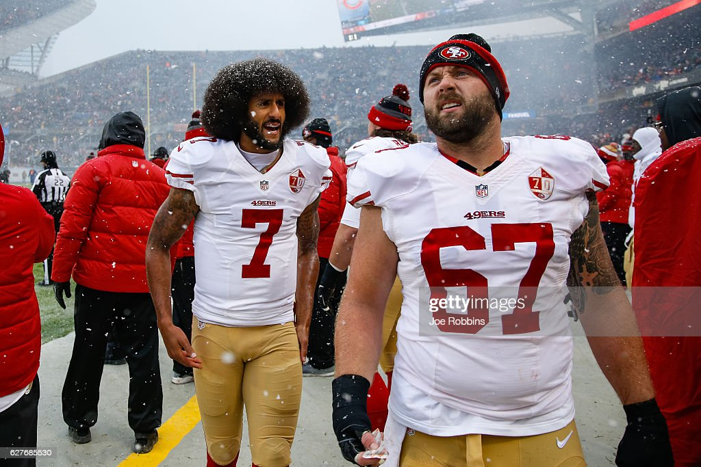 Quarterback Colin Kaepernick #7 of the San Francisco 49ers and Daniel Kilgore #67 stand on the sidelines in the first quarter against the Chicago Bears at Soldier Field on December 4, 2016 in Chicago, Illinois.