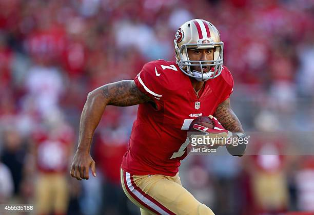 Quarterback Colin Kaepernick of the San Francisco 49ers carries the ball against the Chicago Bears at Levi's Stadium on September 14, 2014 in Santa...