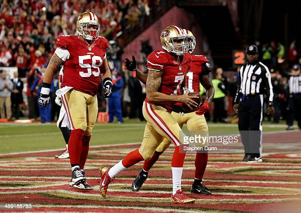 Quarterback Colin Kaepernick of the San Francisco 49ers celebrates a touchdown in the fourth quarter against the Atlanta Falcons during a game at...