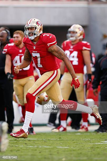 Quarterback Colin Kaepernick of the San Francisco 49ers celebrates after a 21yard touchdown pass against the Baltimore Ravens during their NFL game...