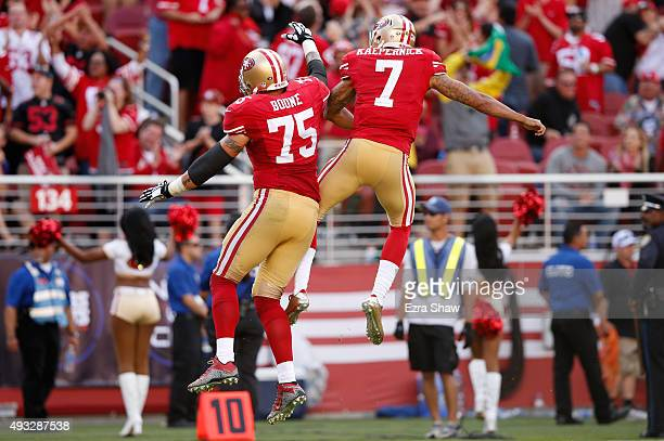 Quarterback Colin Kaepernick of the San Francisco 49ers celebrates with guard Alex Boone after a 21yard touchdown pass against the Baltimore Ravens...
