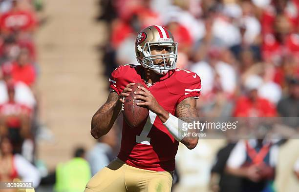 Quarterback Colin Kaepernick of the San Francisco 49ers drops back to pass against the Green Bay Packers at Candlestick Park on September 8, 2013 in...