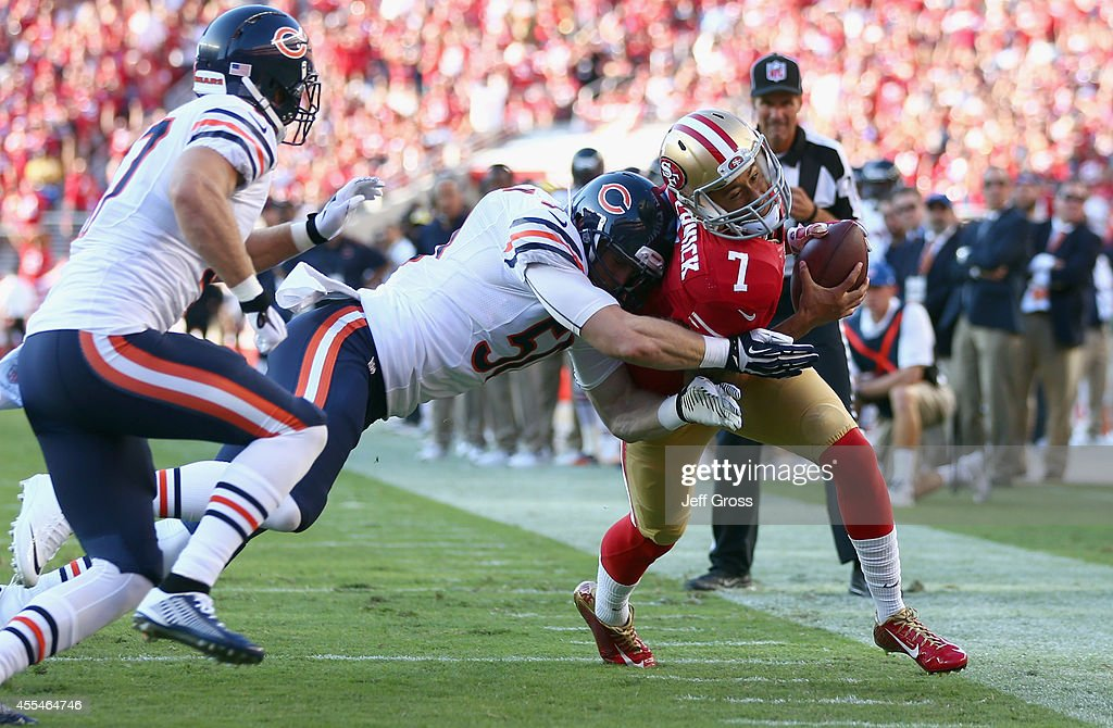 Quarterback Colin Kaepernick #7 of the San Francisco 49ers gets hit by outside linebacker Shea McClellin #50 of the Chicago Bears during the first quarter of their game against the Chicago Bears at Levi's Stadium on September 14, 2014 in Santa Clara, California.